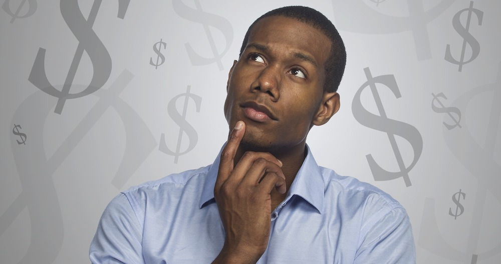 Blog header image of a man thinking about payroll taxes for the Everything You Need to Know About Sage 100 Payroll 2.21.1 article from the ERP experts at SWK Technologies